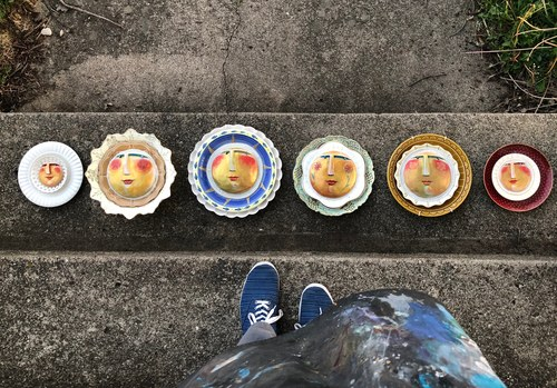 Some of my suns on salvaged plates. And my feet in my favorite keds.