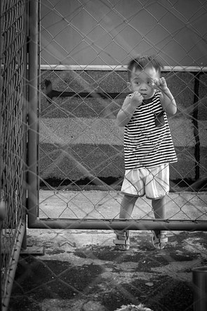 Kid at the fence.